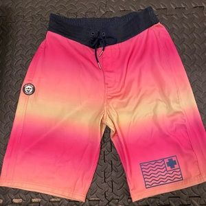 Pink Dolphin Swim Trunks